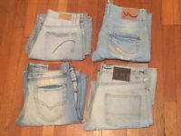 4 pairs of worn men's sandblasted jeans for sale. Waist sizes below