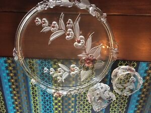 glass serving plate and two matching candle holders