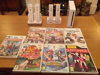 Nintendo Wii Console with 7 games and Wii Fit Board