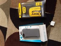2 iPhone 5 cases and adapter.