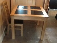 Table and chairs and display cabinet