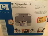 HP Fax/Scanner/copier with phone and an HP photo printer.