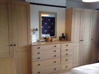 Light oak effect fitted wardrobes, chest of drawers and bedside cabinets