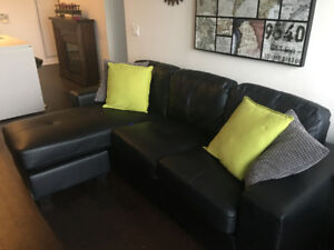 Sofa with Reversible Chaise in Black/ free fire place