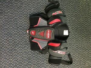 CCM U+ men's size small shoulder pads