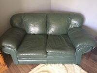 Pair of leather love seats.