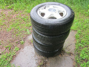 4 X 215/70R 16 Tires with Ford Rims