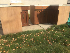 Two Lower kitchen cabinets with countertop, doors, drawers, and
