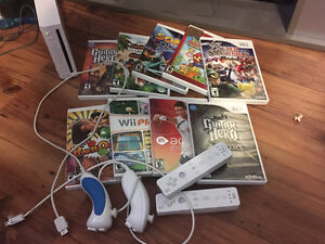 Nintendo Wii + Games + guitars