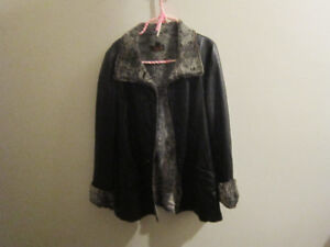 Black Leather coat lined with fur.