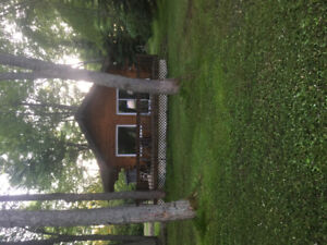 Rustic, two bedroom log cottage for rent on Sturgeon river.