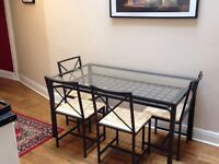 Metal frame dinning table and 4 chairs for sale