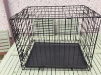 Foldable pet crate with plastic bottom tray
