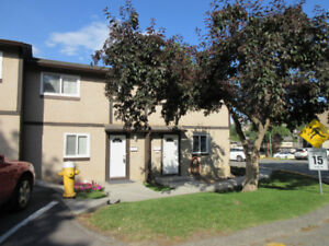 NEWER WINDOWS AND ROOF. 2 level plus basement townhouse