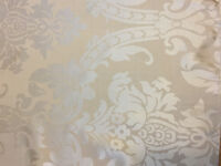 Luxurious cream-coloured wedding table linens