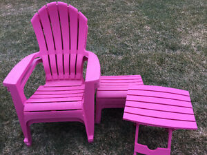 2 pink patio chairs with foot rests and side tables