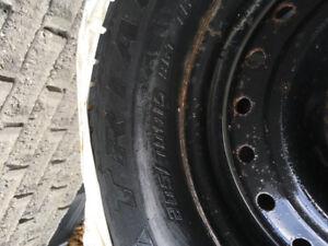 Snow tires P205/70R 15 Snow Lions on GM rims. 5 x 115 mm bolt