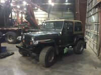 "1994 Jeep YJ Runs excellent. 3"" lift kit, 35"" tire with spare"