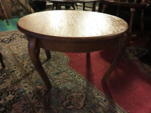 SMALL ROUND ANTIQUE QUARTER SAWN OAK COFFEE TABLE ASKING $115 OR