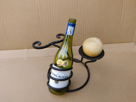 Candle, wine bottle and wine glass holder table decoration
