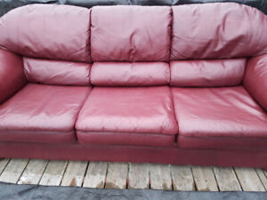 leather couch with ottomans