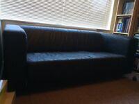 Black two seater sofa