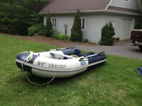 Zodiac with 9.9 HP motor for sale