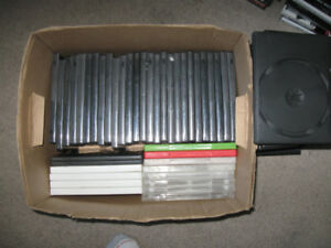 60 New and used DVD Cases + 10cd cases & bonus dvd-$10 flot