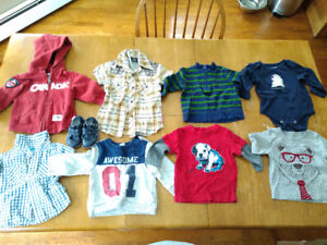 Box of boy clothes with 6-12 Month tags