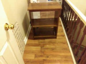 Selling my movie stand/book shelf/ tv stand. $5.00.