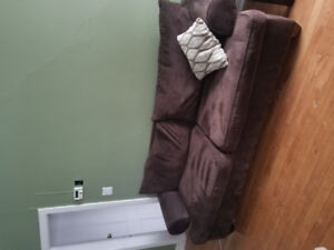 Brown couch and loveseat