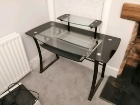 Glass desk with fold-out keyboard support