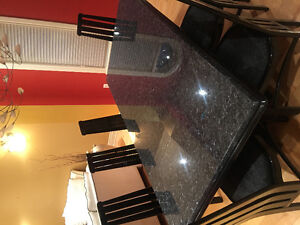 Impeccable granite table and chairs