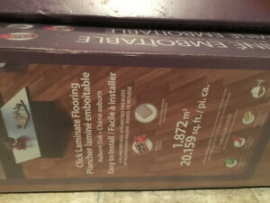 New in box laminate floor must go -60 square feet