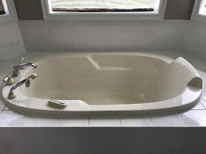 Tub with motor and faucet assembly