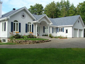 Plain pied bungalow avec garage double maisons for Acheter une maison au canada conditions