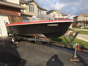 Project boat with trailer for sale.