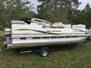 2005 Monark pontoon boat with 140hp outboard
