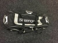 Slazenger junior cricket kit bag with wheels.