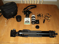 Cannon camera, telephoto lens, carrying case and tripod