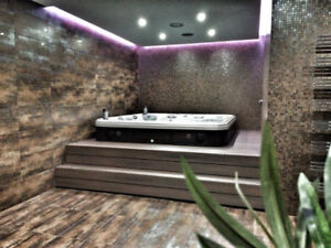 Stay Warm this Winter in a Artesian Hot Tub on Sale Now