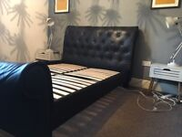 Leather roll top bed. Double