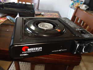 NEVER  USED PORTABLE GAS CAMP STOVE $20.00