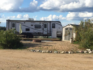 Family trailer at Candle Lake in a quiet RV park
