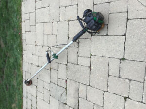 Gas powered grass trimmer ( strait shaft )has a Kawasaski engine