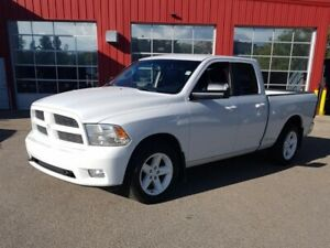 "2011 Ram 1500 4WD Quad Cab 140.5"".     deal pening on this unit"
