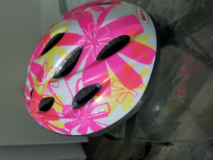 Girl's colourful bike helmet.