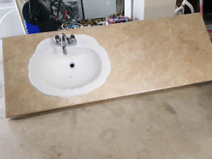 Vanity top with sink and taps