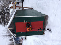 Ice fishing hut and auger