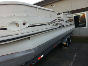 24' Crestliner Pontoon Boat with Dual axles trailer.